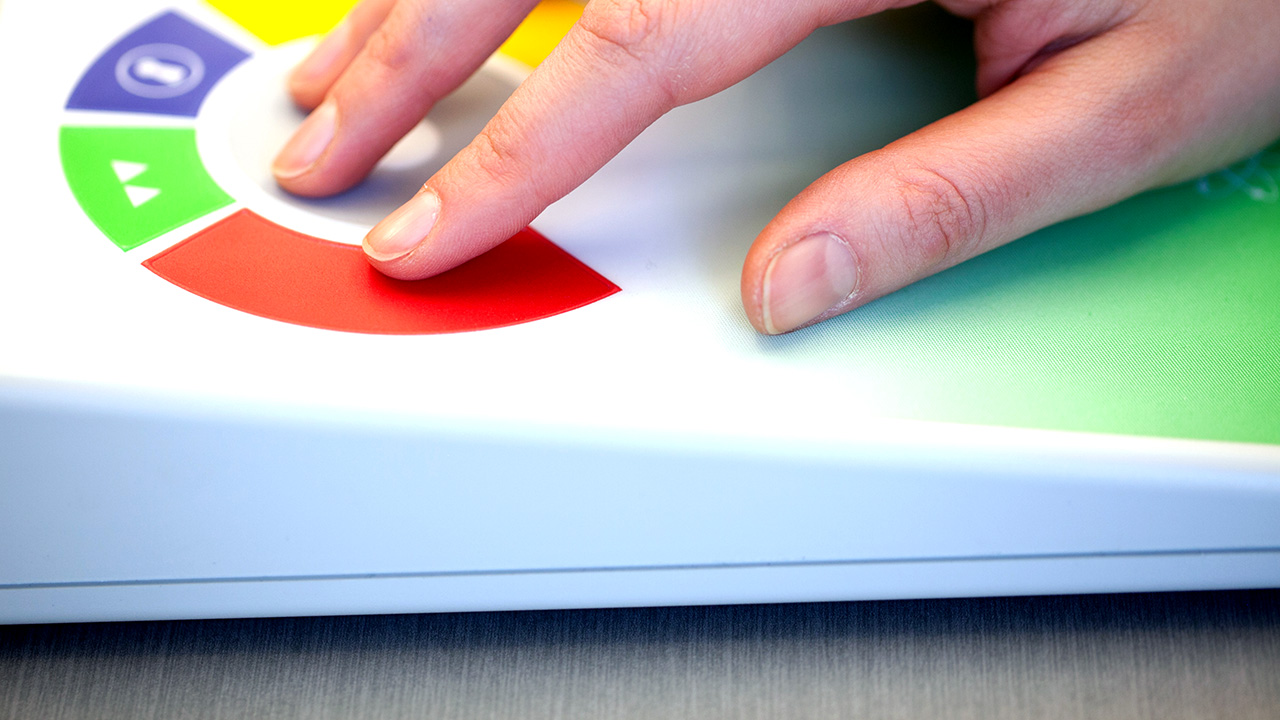 User interacting with coloured buttons